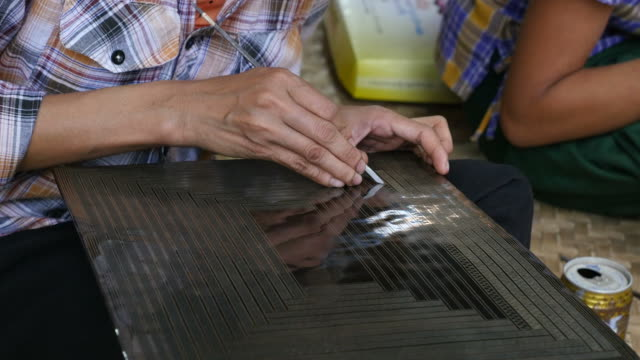 Artisan Intricately Etching a Black Lacquerware Plaque video