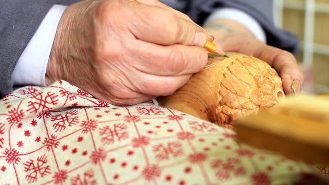 Artisan woodcarver creates a ornament. video