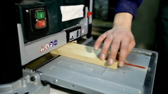 Artisan working with planing machine in workshop video