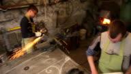 artisans working in workshop video