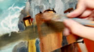 Artist applying a brush stroke to a canvas video