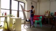 Artist drawing self portrait in studio video