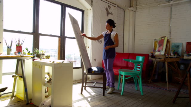 Artist drawing self portrait in studio video