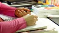 Artist painting in studio video