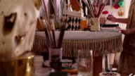 Artist painting on paper at a table in her studio video