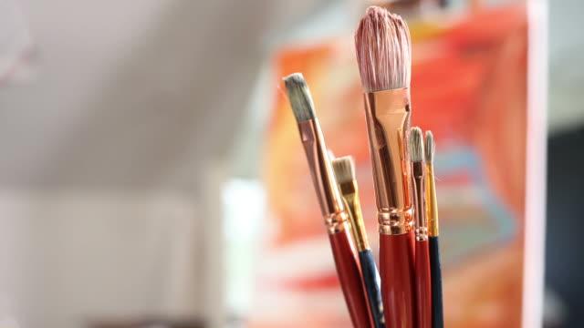 Artist picks up paintbrush video