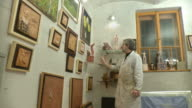 HD DOLLY: Artist Proudly Looking His Gallery video