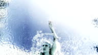 Artist shot of professional female swimmer from underwater slow motion video