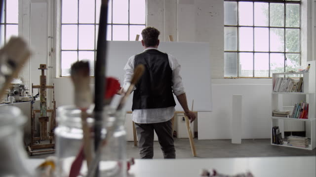 Artist starts painting on canvas video
