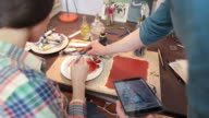 Artist teaching a student using a digital tablet. video