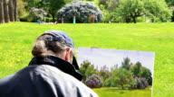 Artist work 'en plein air' lilac. video