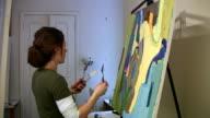 Artist working in the studio. video