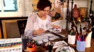 Artist working in the studio video