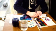 Artist working on painting video