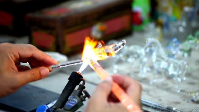 Artist works on glass video