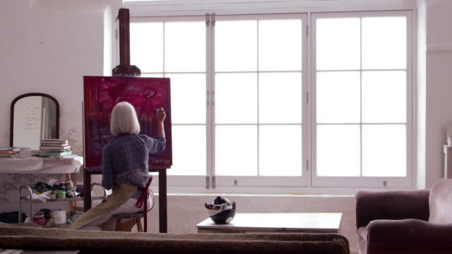 Artist Works On Painting In Daylight Studio Shot On R3D video
