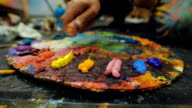 Artists oil paints multicolored closeup abstract video