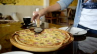 Asia attractive woman eating pizza slice in pizzeria video