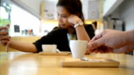 asia woman using smartphone and coffee on table video