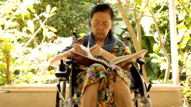 Asian adult woman sitting on her wheelchair video