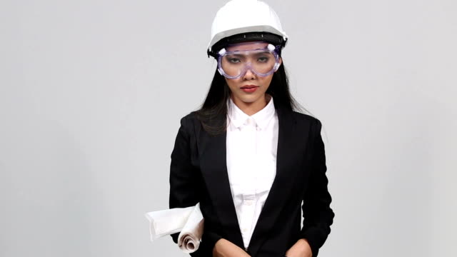 Asian Architect Engineer woman in white hard hat,  , concept woman can do video