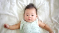 asian baby laydown on white bed video