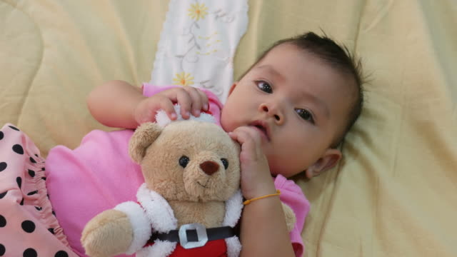 Asian baby smiling with Christmas  toy video