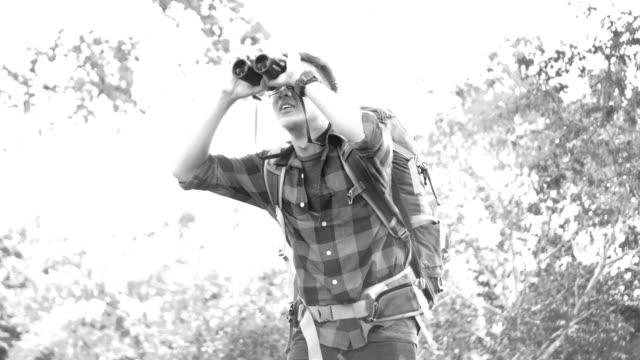 Asian backpacker enjoy Bird-watching video