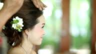 Asian bride having hairdo on her wedding day video