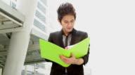 Asian business man in modern city video