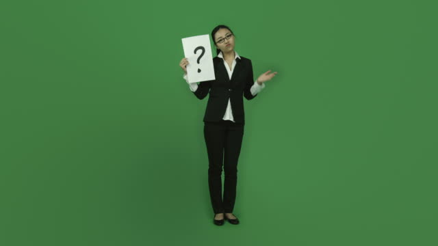 Asian business woman isolated greenscreen green background confused puzzled video