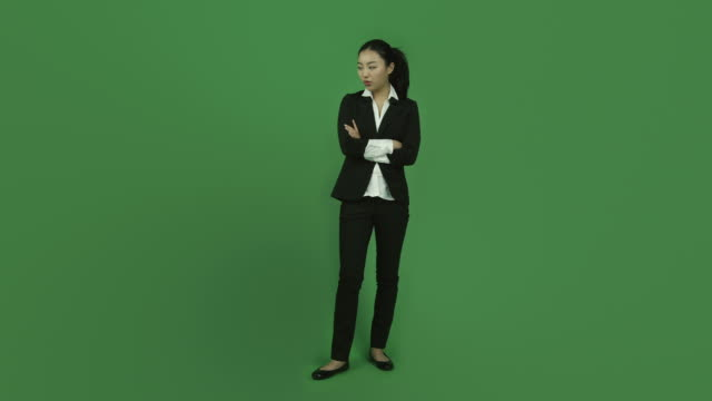 Asian business woman isolated greenscreen green background upset arms crossed video