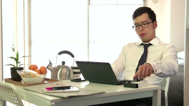 Asian Businessman Business Man Working With Laptop Pc During Breakfast video