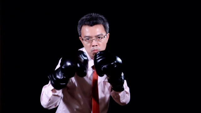 Asian businessman in boxing concept video