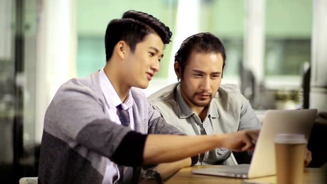 asian businessmen working together in office video