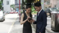 Asian businesspeople with a smartphone video