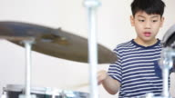 Asian child drummer practicing for a performance video