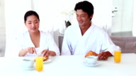 Asian couple having breakfast together video