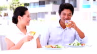 Asian couple having white wine with their meal video