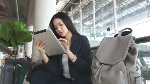 Asian cute women play tablet video