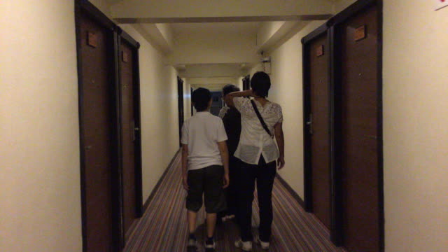 Asian family walking in hotel hall video