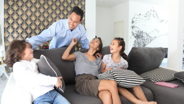 Asian Father Coming Home to Watch TV With His Family video