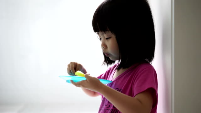 Asian female child eating ice-cream video
