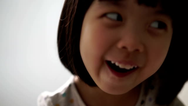 Asian female child enjoying her tooth brushing routine video