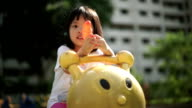 Asian female child playing with water gun video