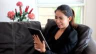 Asian Female Office Worker Talking On Tablet video