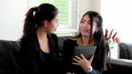 Asian Female Office Workers Using Tablet video