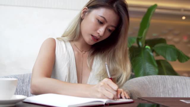 Asian female student learning english language video