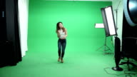 Asian Girl Dancing on Green Background video