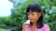 Asian Girl Eating A Popsicle video